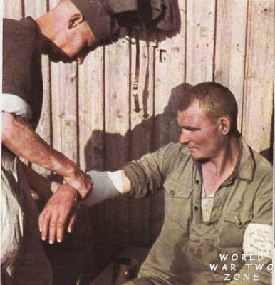 The+man+having+his+wound+dressed+is+a+volunteer+out+of+the+ranks+of+Soviet+POWs